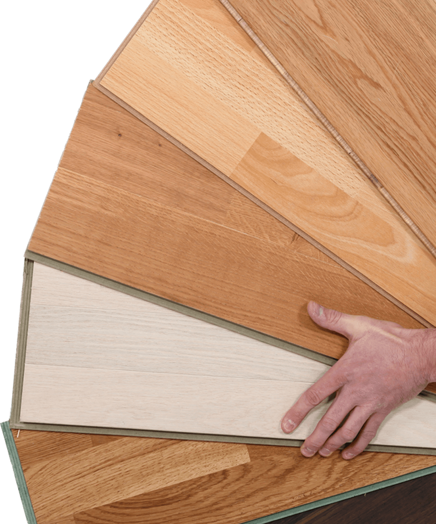Man Displaying Variety Of Laminate Flooring
