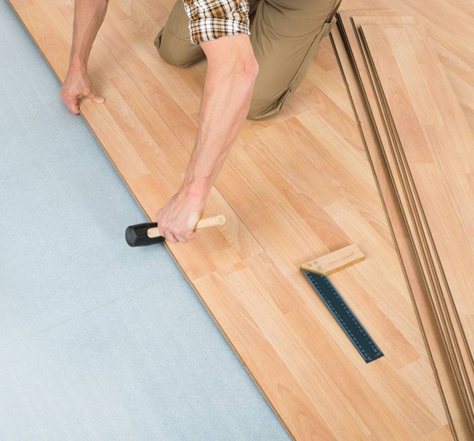Carpenter Installing Floor